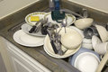 Dirty dishware in the sink Royalty Free Stock Photo