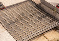 Dirty drain iron grate off the Royalty Free Stock Photo