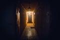 Dirty empty dark corridor in apartment building, doors, lighting lamps Royalty Free Stock Photo