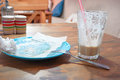 Dirty empty plate and half empty glass of coffee on the table side view Royalty Free Stock Images