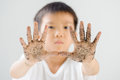Dirty hand close up with thin focus on little of young asian boy with black soil and after gardening ecology and earth day concept Royalty Free Stock Image