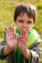Dirty hands kid showing his Royalty Free Stock Photography