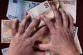 Dirty hands and money Royalty Free Stock Photo