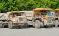 Dirty haul trucks sunny scenery with in a row Stock Image