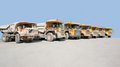 Dirty haul trucks sunny scenery with in a row Stock Photo