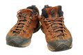 Dirty hiking leather shoes coming mountains Royalty Free Stock Image