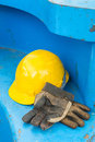 Dirty leather gloves and safety helmet close up using in construction site Stock Photo