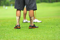 Dirty legs of golf player Royalty Free Stock Photo
