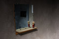 Dirty mirror in empty dark jail cell Royalty Free Stock Photo