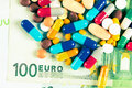 Dirty money and drugs pills from above Stock Photography