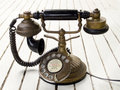 Dirty old classic retro style analog telephone Stock Images