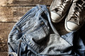 Dirty old jeans and sneakers Royalty Free Stock Photo