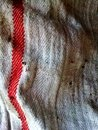 Dirty rag macro detail of a kitchen with stains and a red stripe Stock Photos
