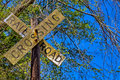 Dirty rail road crossing sign on wooden post Royalty Free Stock Photo