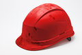 Dirty red hard hat Royalty Free Stock Photo