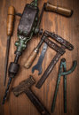 Dirty set of hand tools on a wooden panel Royalty Free Stock Image