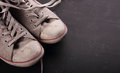 Dirty sneakers with copy space Royalty Free Stock Photo