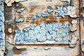 Dirty stripped paint in the blue wet wood door and rusty nail Royalty Free Stock Photos