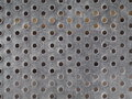 Dirty surface abandoned rustic circle hole aluminium sheet plate Royalty Free Stock Photo