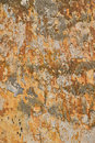 Dirty wall with peeling plater and rusty stains Royalty Free Stock Photo