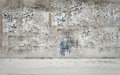 Dirty wall urban with torn off posters Royalty Free Stock Photos
