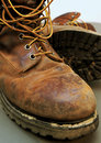 Dirty work boots with mud and scratches Stock Photography