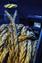 Dirtymooring line on winch. Background. Copy space. Blur. Blue and yellow