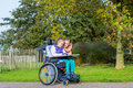 Disabled girl in a wheelchair relaxing outside