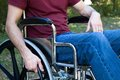Disability man wheelchair disabled by an accident sits in a outside Royalty Free Stock Image