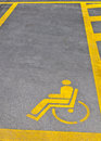 Disability parking sign on road Stock Photography