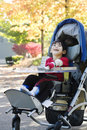 Disabled boy in medical wheelchair at park Stock Image