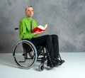 Disabled business man in wheelchair with book Royalty Free Stock Photo
