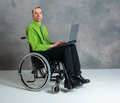Disabled business man in wheelchair with computer Royalty Free Stock Photo
