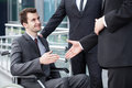 Disabled businessman shaking hand with business partners Royalty Free Stock Photo