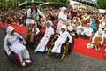 Disabled kid line up to get free rice ahead of eid in solo central java indonesia Royalty Free Stock Photo
