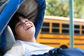 Disabled little boy in wheelchair by bus Royalty Free Stock Images