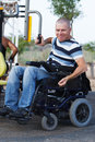 Disabled male in wheelchair working out with trainer Stock Image