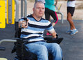 Disabled male in wheelchair working out with trainer Royalty Free Stock Photo