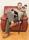 Disabled man with cat Royalty Free Stock Image