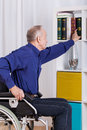 Disabled man during everyday activities on wheelchair Stock Photography