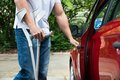 Disabled man opening door of a car Royalty Free Stock Photo