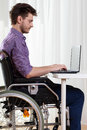 Disabled man surfing on the Internet Royalty Free Stock Photo