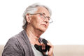 Disabled old person home alone with crutch senior woman in glasses gray hair portrait day dreaming thoughtful sad indoor isolated Stock Images