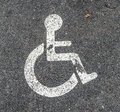 Disabled parking permit sign on the street painted Royalty Free Stock Photo