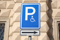 Disabled parking sign on cream wall background Royalty Free Stock Image