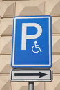 Disabled parking sign on cream wall background Stock Images