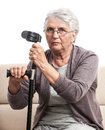Disabled person old woman crutch with in glasses gray hair sad expression close up indoor isolated on white Royalty Free Stock Photo