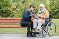 Disabled retiree in park Royalty Free Stock Photo