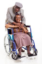 Disabled senior african woman husband happy women and her caring on white background Royalty Free Stock Photography