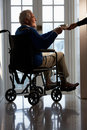 Disabled Senior Man Sitting In Wheelchair Stock Photos